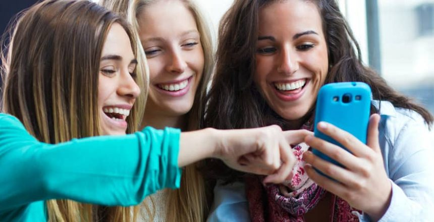 A group of friends having fun with smartphones